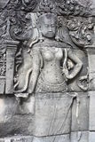 Apsara dancer. Carved into the walls of Angkor Wat, more than 1,000 dancer statues, none replicated, dot the walls of the famous temple in Cambodia Royalty Free Stock Photos