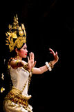 Apsara dancer. SIEM REAP, CAMBODIA – May 2012: A traditional Khmer Cambodian female dancer in Apsara dance pose against black Stock Photography
