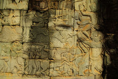 Apsara dancer bas-relief on ancient Angkor temple. Female figure carved in a stone-bas relief on an ancient Angkorian temple in Angkor Wat, Cambodia. A female Stock Image