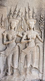 Apsara dancers. Ancient relief of the Apsara dancer on the stone wall Royalty Free Stock Image