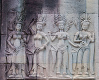 Apsara Dancers of Angkor Wat. Detail of apsara dancers carved at the Angkor Wat complex in Cambodia Royalty Free Stock Photography