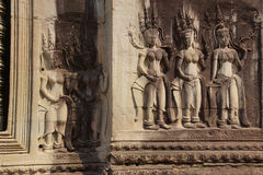 Apsara dancers decorate Angkor Wat Stock Photography