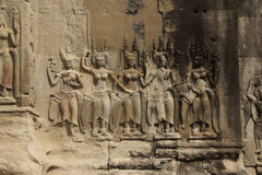 Apsara dancers decorate Angkor Wat Stock Image