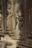 Apsara dancers decorate Angkor Wat Stock Photo
