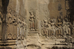 Apsara dancers decorate Angkor Wat Stock Photo