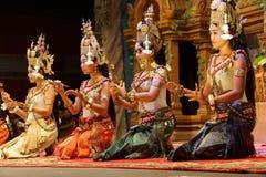 Apsara dancers kneel. SIEM REAP, CAMBODIA - FEB 14, 2015 - Apsara dancers kneel at the end of a performance, Siem Reap,  Cambodia Royalty Free Stock Images