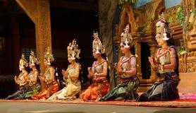 Apsara dancers kneel Stock Photo