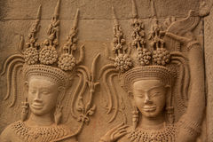 Apsara dancers stone carving at Angkor Wat temple Royalty Free Stock Images