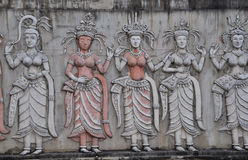 Apsara. Ornate bas-reliefs of Apsara on the wall Stock Photography