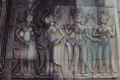 Apsaras an old Khmer art carvings on the wall in Angor Wat temple Stock Image
