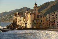 Apse of Assunta church on white froth of rough sea, Camogli, Ita Stock Image