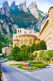 Apse of basilica of Montserrat and music school Eskolaniya monastery against rocks Stock Photography