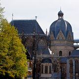 Apse Dom Cathedral Aachen, Germany. The apse and copula of the Dom or cathedral of Aachen, Germany, in Gothic and Romanesque style with a tree royalty free stock photo