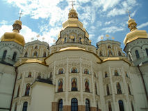 Apses of the Dormition cathedral of the Laura. The Kiev-Pecherskaya Laura (or Kiev Laura of the Caves) is the monastery of the highest rank in Ukraine, based in stock image