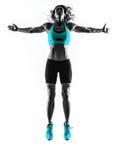 Aptidão da mulher que salta esticando a silhueta dos exercícios Fotos de Stock Royalty Free