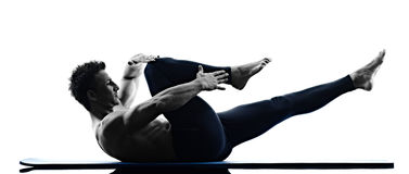 Aptitud de los ejercicios de los pilates del hombre aislada Fotos de archivo