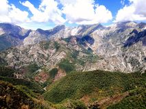 Apuan Alps. Panoramic view of a portion of the mountain range of the Apuan Alps in a sunny day with white clouds Stock Image