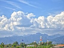 Apuan Alps in Viareggio, Italy. Under snowy clouds Royalty Free Stock Photo