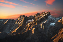 Apuane alpi snowy mountains and marble quarry at sunset in winte Stock Photography
