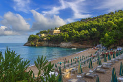 Apula coast,Gargano National Park: Pungnochiuso beach. Vieste,Italy.The bay is bounded by marvellous hills covered with age-old p Stock Images