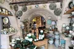 Apulia ceramics. GROTTAGLIE, ITALY - JUNE 3, 2017: People visit a traditional ceramics shop in Grottaglie, Italy. Grottaglie is a famous handmade ceramics Royalty Free Stock Image