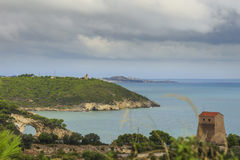 Apulia coast: panoramic view of San Felice Bay, Italy.Gargano National Park: the little rock arch,Architello or San felice Arch. Stock Photos