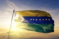 Apure State of Venezuela flag textile cloth fabric waving on the top sunrise mist fog. Beautiful royalty free stock photo