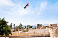 The Aqaba Flagpole under ruins. Of medieval Mamluks Aqaba fort stock photo
