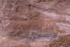 Fragment of surviving rock inscriptions left over from ancient times on a rock in the Wadi Rum desert near Aqaba city in Jordan. Aqaba, Jordan, December 07, 2018 royalty free stock photo