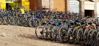 Aqaba, Jordan, March 7, 2018: Bicycle rental on the beach of Aqaba with many bikes for tourists and locals Royalty Free Stock Photo