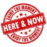 Aquí y ahora sello de goma Foto de archivo libre de regalías