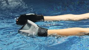 Aqua Aerobics Equipment. Aqua fitness is regarded as one of the safest fitness workouts and is suitable for a wide range of people: pregnant women, elderly stock photos