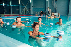 Aqua aerobics, healthy lifestyle, water sport. Indoor swimming pool, recreational leisure stock photo
