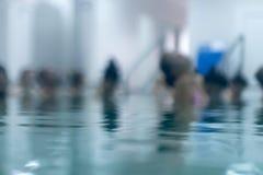Aqua aerobics in the pool. Aqua fitness. Blurred. Aqua aerobic Stock Image