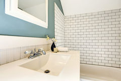 Aqua bathroom with white tile wall trim. Stock Photography