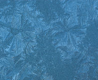 Aqua Blue Frost Ice Background. Ice patterns against a blue background stock photography