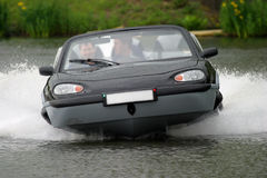 Aqua Car. An Aqua Car at full speed on water stock photo