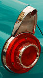Aqua Car Tail Light. The red and chrome tail light on the back of a classic car stock photo