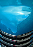 Aqua Classic Car Hood. The hood and chrome front grill of a classic car Royalty Free Stock Photos