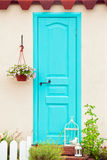 Aqua color door entrance to the house Royalty Free Stock Image