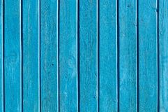 Aqua colored wooden gate with iron stripes stock image