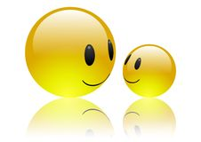 Aqua Emoticons - Friendship. Two shiny emoticons on reflective white background smiling at each other in friendship Royalty Free Stock Photos