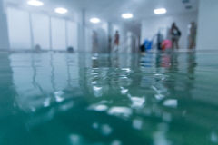 Aqua fitness class beginning. Blurred. Stock Image