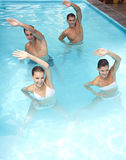 Aqua fitness in swimming pool. Happy group doing aqua fitness in swimming pool Royalty Free Stock Images