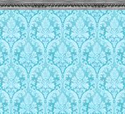 Elegant Wall of Aqua Damask Wallpaper With Ornate Molding royalty free stock photos