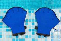Aqua gloves Stock Photos