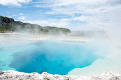 Aqua Hot Spring. This was one of the more beautiful blue hot springs at Yellowstone National Park. The color of the water was very clear and aqua blue. The color Stock Photography