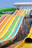 Aqua park on the beach. Colorful waterslide in an aquapark in the seaside town of Port Iron Ukraine. season August Royalty Free Stock Images