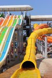 Aqua park on the beach. Colorful waterslide in an aquapark in the seaside town of Port Iron Ukraine. season August Royalty Free Stock Photo
