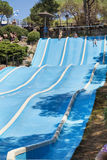 Aqua park fun -Young man riding down a water slide in water park Marineland. BARCELONA,SPAIN - JUNE 26, 2016: Marineland is a dolphinarium, marine zoo, and water Stock Image